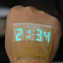 (PDF) A Stretchable Stopwatch Lights Up Human Skin