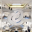 Leandro Erlich Twists Le Bon Marché's Famed Escalator Into Pretzel-like Form